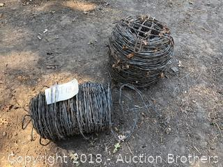 Three Rolls of Barb Wire