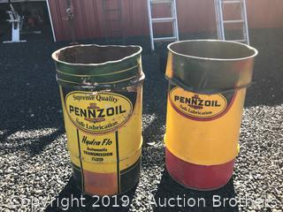Two Pennzoil metal drums