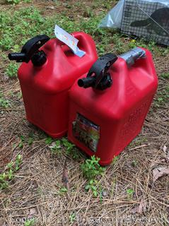 Two Plastic Gas Cans