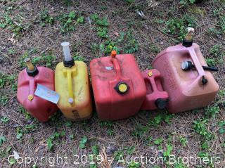 Five Plastic Gas Cans